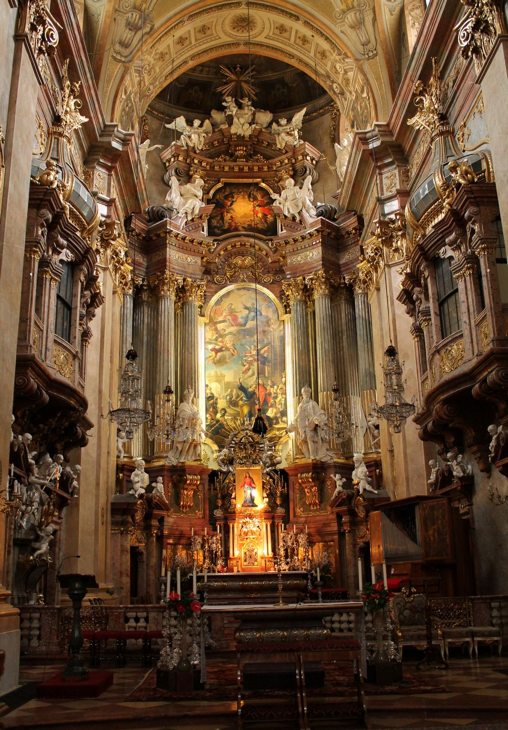 Source: Sarah Stierch (CC BY 4.0 license), at https://commons.wikimedia.org/wiki/File:Interior_of_St._Peter%27s_Church,_Vienna_-_Stierch_-A.jpg